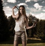 Beautiful woman with golfclub on her shoulders Stock Images