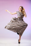 Beautiful  woman in gorgeous dress, motion shot Royalty Free Stock Photo