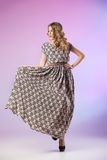 Beautiful  woman in gorgeous dress, motion shot Royalty Free Stock Photography
