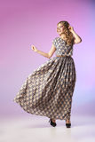 Beautiful  woman in gorgeous dress, motion shot Royalty Free Stock Photos