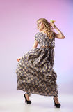Beautiful  woman in gorgeous dress, motion shot Royalty Free Stock Image
