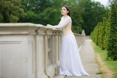 Beautiful woman in gothic dress. Longingly watching out Royalty Free Stock Photography