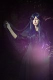 The beautiful woman in Gothic style in the forest Stock Photography