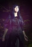 The beautiful woman in Gothic style in the forest Royalty Free Stock Images