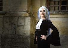 The beautiful woman in Gothic style with long blond hair near church Stock Photography