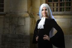The beautiful woman in Gothic style with long blond hair near church Royalty Free Stock Photography