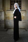 The beautiful woman in Gothic style with long blond hair near church Royalty Free Stock Image