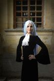 The beautiful woman in Gothic style with long blond hair near church Stock Images