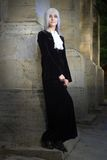 The beautiful woman in Gothic style with long blond hair near church Royalty Free Stock Images