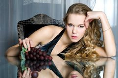 Beautiful woman with grape Stock Photography