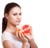 Beautiful woman with grapefruit Royalty Free Stock Photo