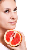 Beautiful woman with grapefruit Royalty Free Stock Photography