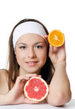 The beautiful woman with a grapefruit Stock Images