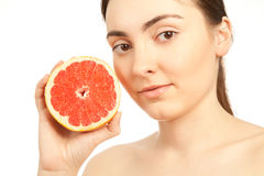 Beautiful woman with grapefruit isolated on white Stock Photo