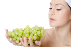 The beautiful woman with grapes Royalty Free Stock Images