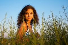Beautiful woman in grass Stock Images