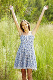 Beautiful woman in grass Stock Photos