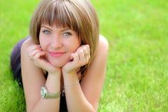 Beautiful woman on the grass Stock Photo