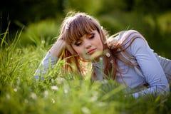 Beautiful woman in grass Stock Photo