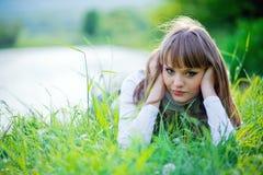 Beautiful woman in grass Stock Image