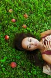 Beautiful woman on the grass with peaches Royalty Free Stock Photo