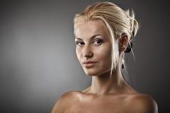 Beautiful woman on gray background Stock Photography