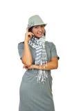Beautiful woman in gray dress royalty free stock image