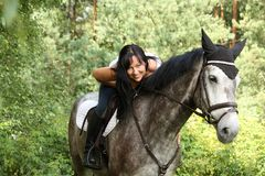 Beautiful woman and gray horse portrait in garden Royalty Free Stock Image
