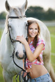 Beautiful woman with gray horse Stock Images