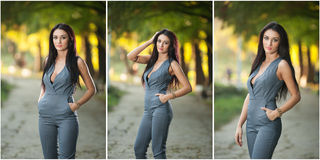 Beautiful woman in gray posing in autumnal park. Young brunette woman spending time during autumn in forest Royalty Free Stock Photo
