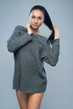Beautiful woman in  gray sweater Royalty Free Stock Photos