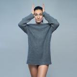 Beautiful woman in  gray sweater Stock Photos