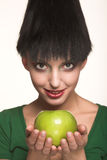 Beautiful woman with  green apple Stock Image