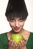 Beautiful woman with  green apple Stock Image