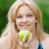 Beautiful woman with green apple Stock Photo