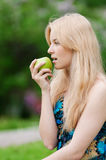 Beautiful woman with green apple Stock Photography