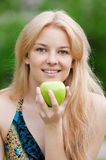 Beautiful woman with green apple Stock Images