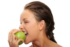 Beautiful woman with green apple Royalty Free Stock Photography