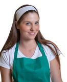 Beautiful woman with a green apron Royalty Free Stock Photo