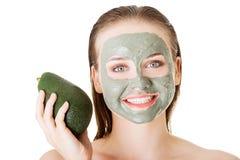 Beautiful woman with green avocado clay facial mask Royalty Free Stock Image