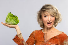 Beautiful woman with green cabbage Royalty Free Stock Image