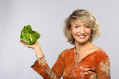Beautiful woman with green cabbage Royalty Free Stock Photography