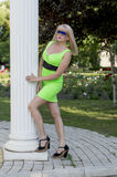 The beautiful woman in green at colons in the park Royalty Free Stock Photography