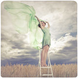 Beautiful woman in green dress background Royalty Free Stock Image