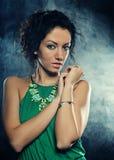 Beautiful woman in green dress Stock Photo