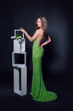 Beautiful woman in a green evening dress on a black background royalty free stock photo