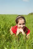 Beautiful woman on  green field Stock Photos