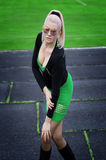 The beautiful woman in green at the football field Royalty Free Stock Images