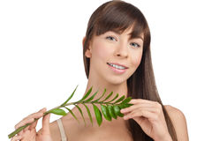 Beautiful woman with green leaf Royalty Free Stock Photo