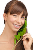 Beautiful woman with green leaf Royalty Free Stock Image